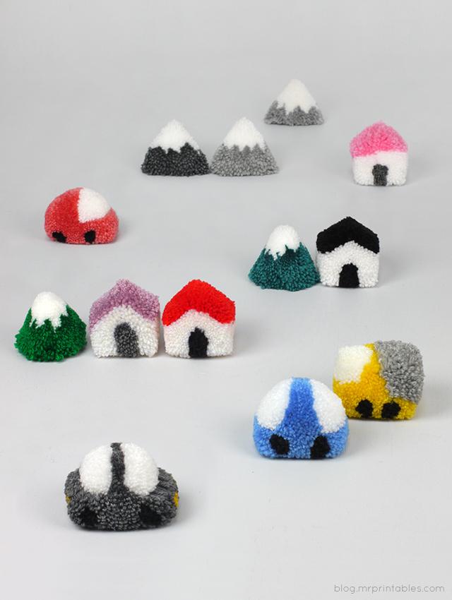 Case, auto, alberi e montagne fatte in lana con la tecnica del pon-pon
